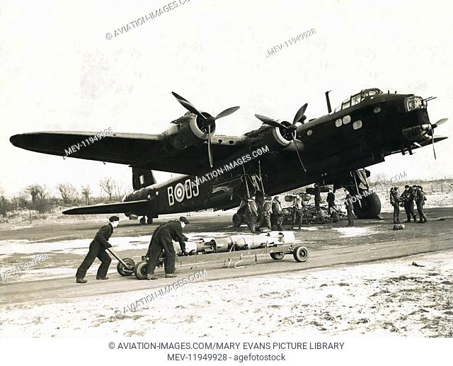 An RAF 149 Squadron Short Stirling Heavy Bomber with Pilot, Air & Ground Crew & Bombs. it Has a Top Speed of 280Mph, a Loaded Weight of 70,000Lb