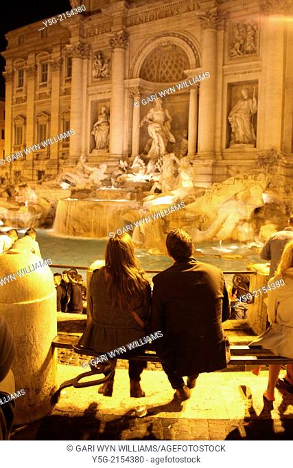 people by the trevi fountain at night in rome italy