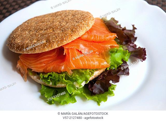 Healthy fast food: sandwich of smoked salmon with lettuce