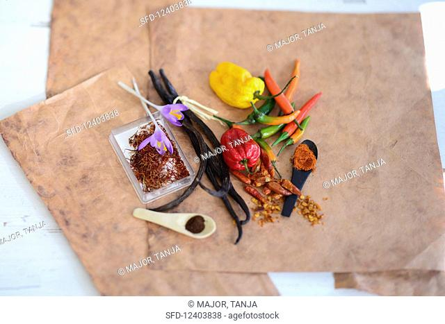 An arrangement of spices with saffron, vanilla pods and chillis
