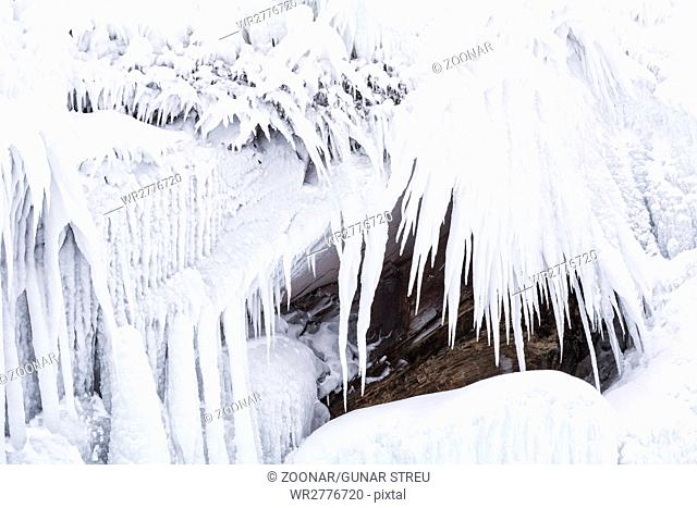 Icicles on a rock, Lake Tornetraesk, Lapland, Sweden