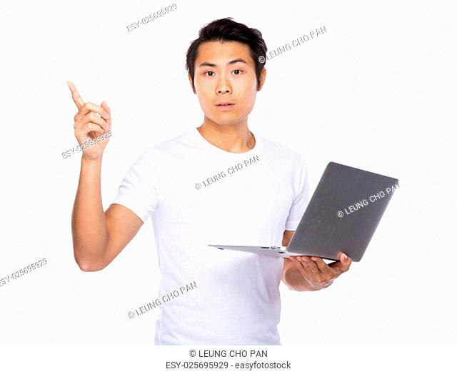 Man holding laptop computer and finger point up