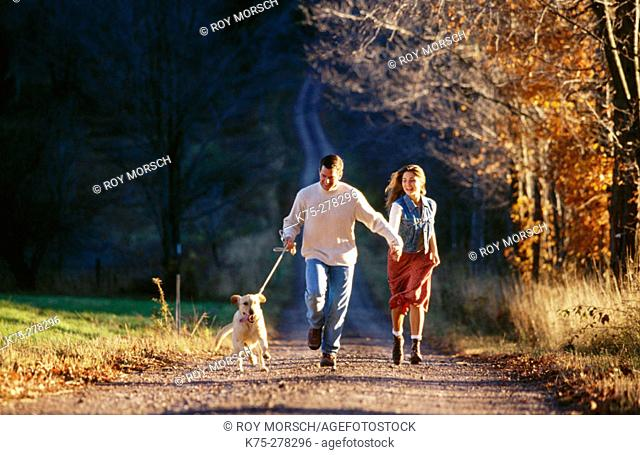 Couple walking with their dog