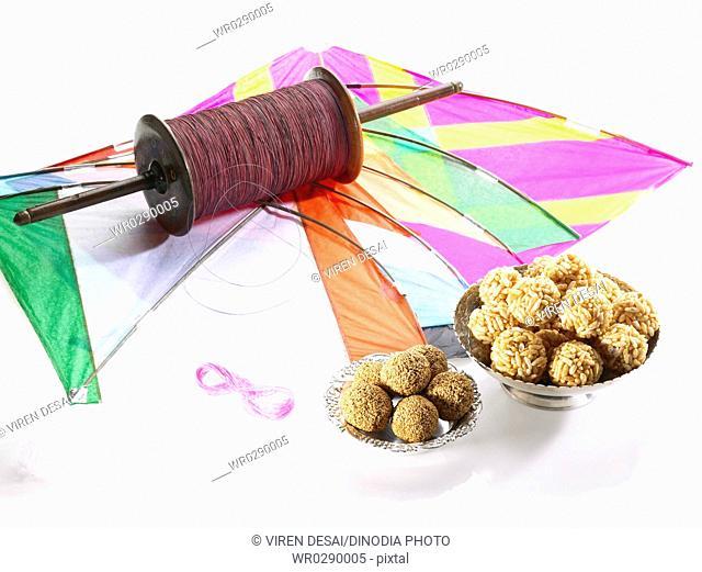 Colourful five kites thread manja firki with sesame puffed rice laddoo on celebration of Makara Sankranti festival