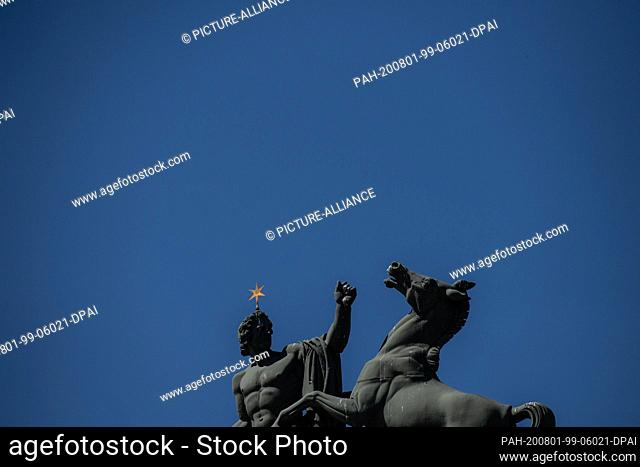 31 July 2020, Berlin: The sculpture on top of the Altes museum stands out against the blue sky. Photo: Paul Zinken/dpa-zentralbild/dpa