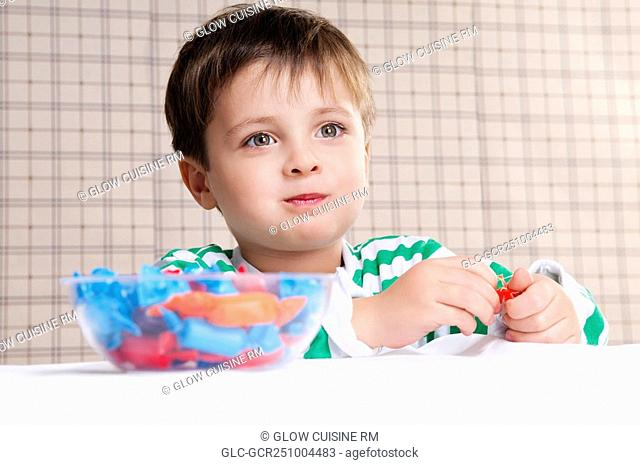 Close-up of a boy eating a candy