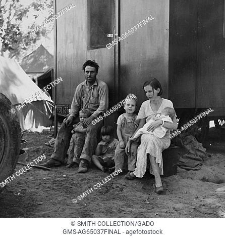 A migrant worker, his young wife and four children resting outside their temporary lodgings, situated on a migrant camp, Marysville, California, 1935