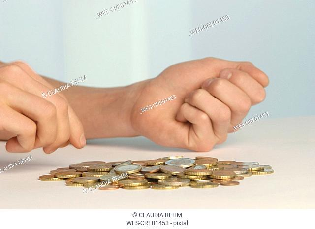 Hands counting coins