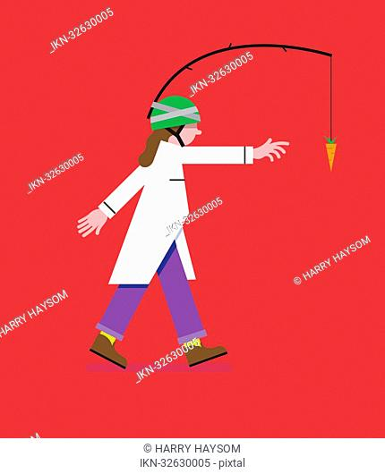 Woman reaching for carrot on stick