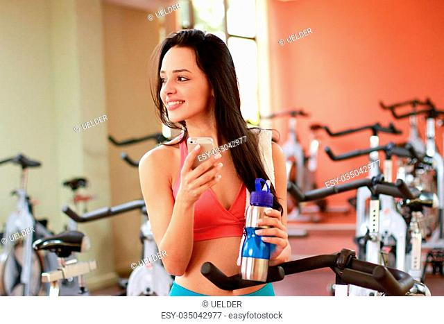 Woman talking on cell in fitness