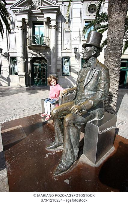 Girl with the the monument of Hans Christian Andersen in Málaga, Andalucía, Spain, Europe