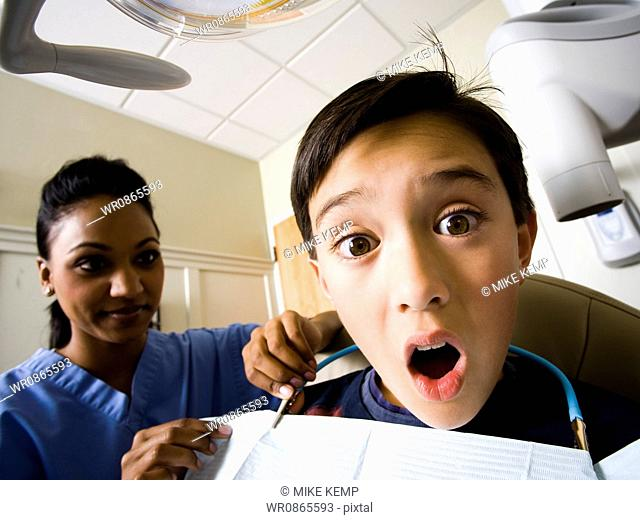 Boy at dentist with hygienist