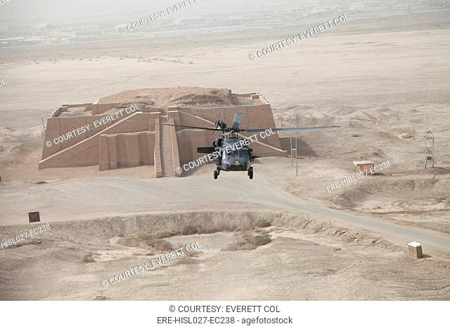 A US Army Black Hawk helicopter hovers above the ancient Ziggurat of Ur near Nasiriyah Iraq Oct. 11 2009. Aerial view shows the upper steps of the ancient...
