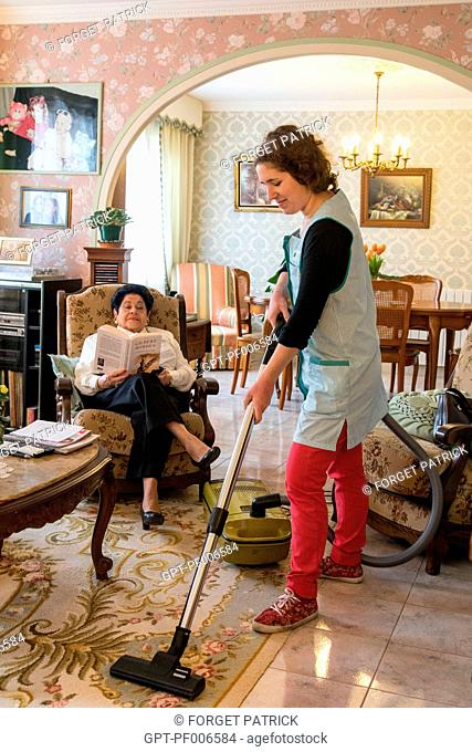 HOUSEWORK (VACUUMING), ADMR (AIDE A DOMICILE EN MILIEU RURAL), HOME HELP, NOGENT-LE-ROI (28), FRANCE