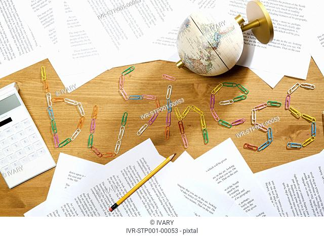 Clips With Calculator, Papers, Pencils And Globe