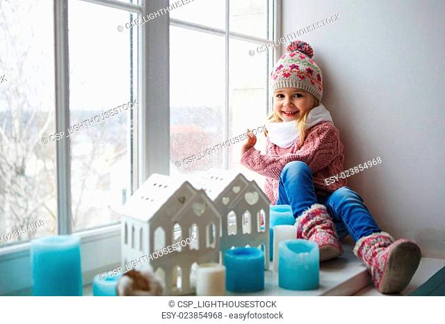 Sitting on a window sill