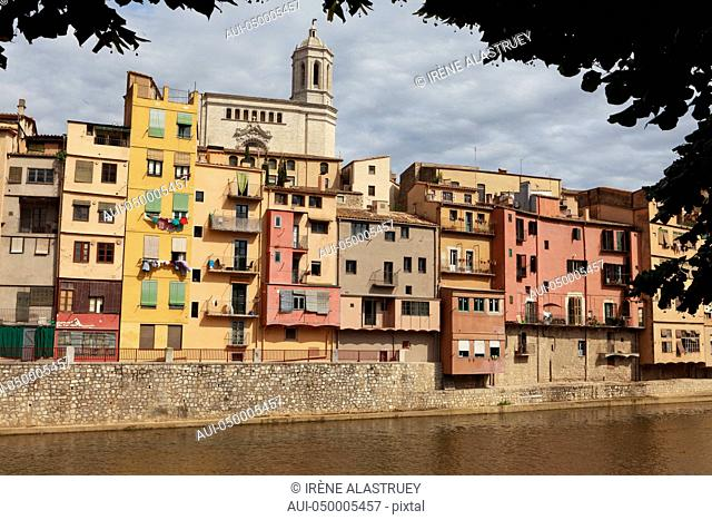 Spain - Costa Brava - Figueres - Old houses on Onyar River with the cathedral