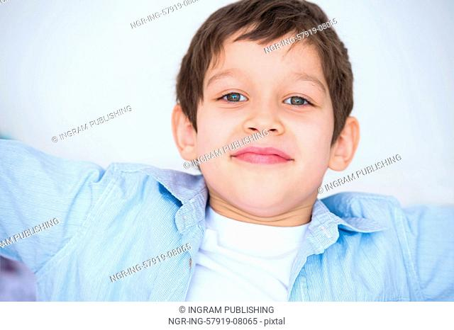 Close up portrait of a kid smiling to the camera