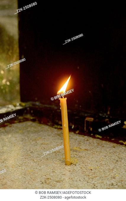 Lit candle st Beograd in Serbia