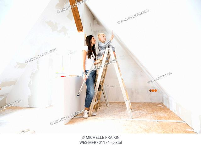 Mother and son working on loft conversion