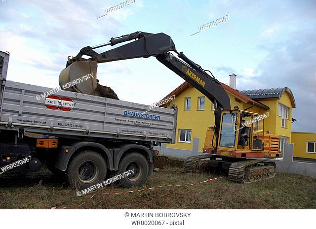 excavator loading earth onto lorry