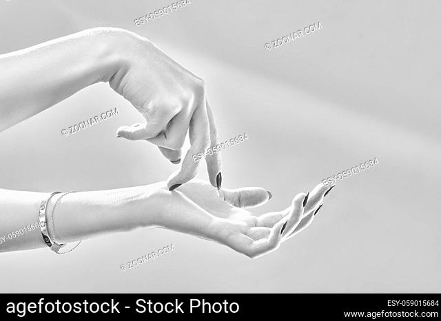 luxury female hands on white background posing close up, monochrome