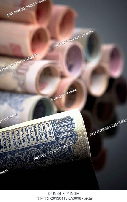 Close-up of rolled-up Indian paper currency