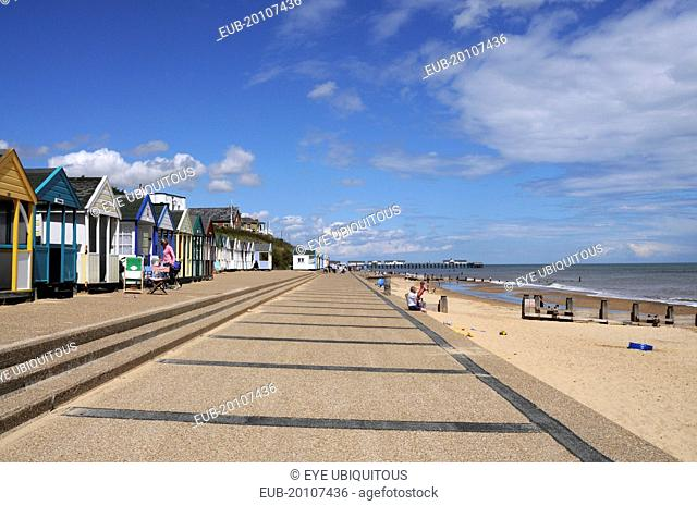 Beach Huts near the pier with Sea Defences and Holidaymakers