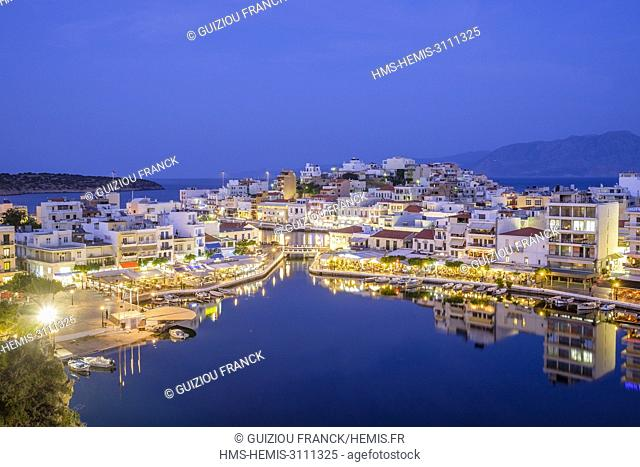 Greece, Eastern Crete, Lassithi district, Agios Nikolaos, Voulismeni lake in the heart of the town is connected to the sea by a canal