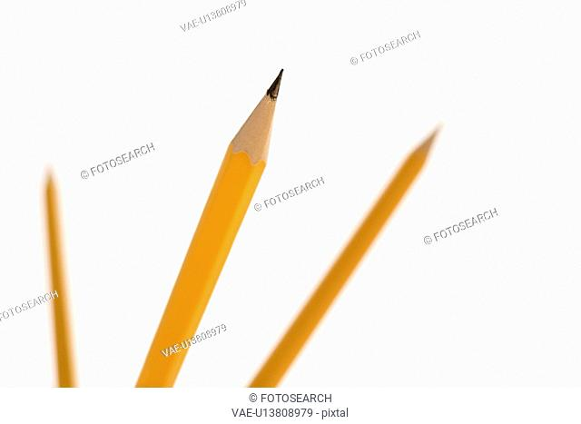 Three pencils pointing in air with selective focus