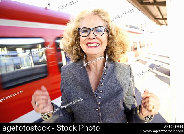 Bavarian senior woman in S-Bahn station. Munich, Germany