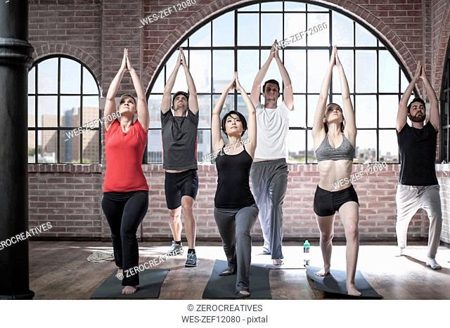 Yoga class exercising in studio