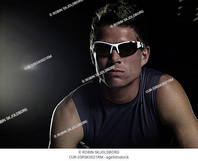 Runner in sunglasses at starting line