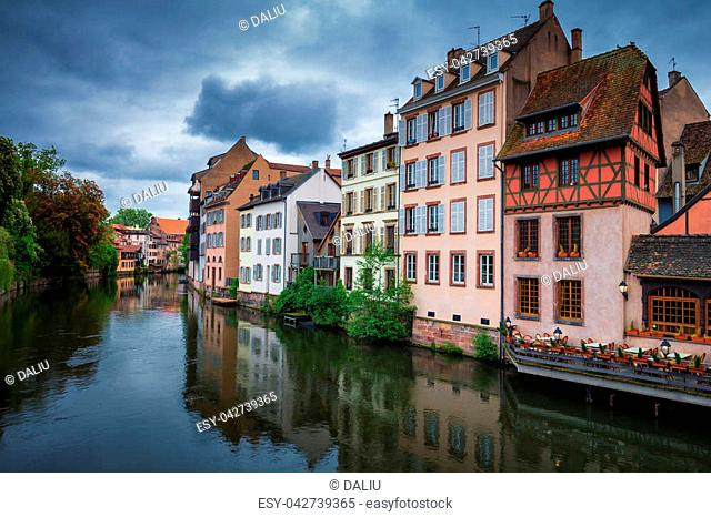Beautiful view of the historic town of Strasbourg, colorful houses on idyllic river. Strasbourg, France