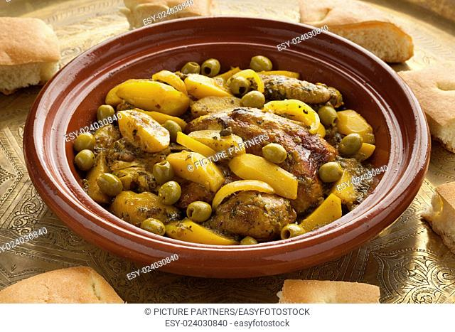 Traditional moroccan tajine with chicken,pototoes and olives