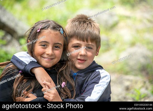 Young children outdoor. Happy brother and sister in the park