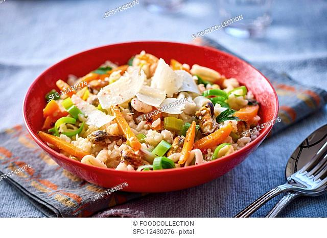 Risotto with seafood, vegetables and Parmesan cheese