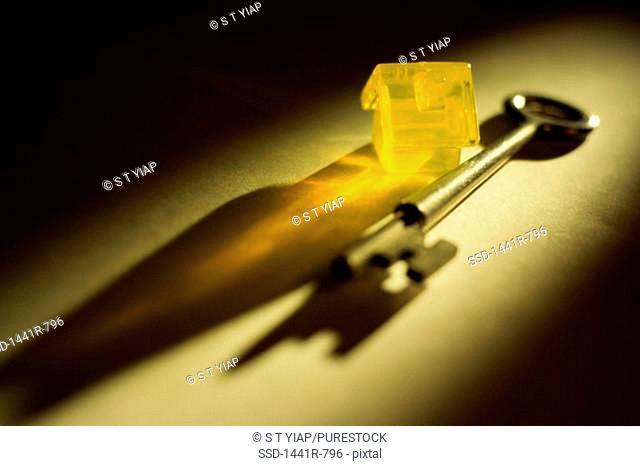 Close-up of a key and a miniature house