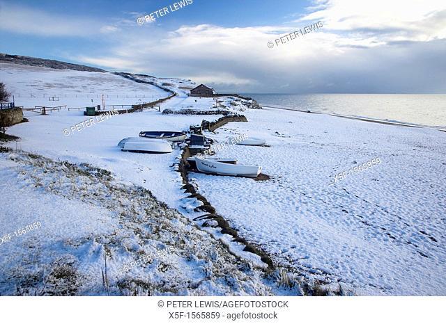 Rare occurance of Snow covered Chesil Beach and Boats at Burton Bradstock Dorset