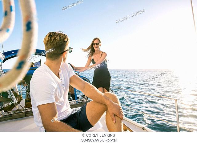 Couple chatting on sailboat, San Diego Bay, California, USA