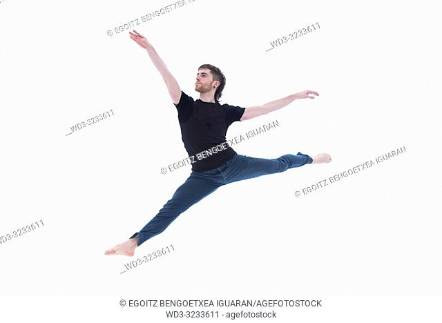 Casual dressed classic dancer on white background