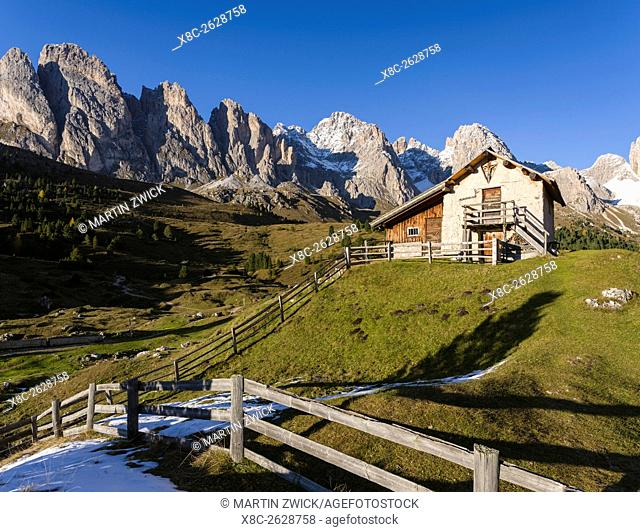 Geisler mountain range - Odle in the Dolomites of the Groeden Valley - Val Gardena in South Tyrol - Alto Adige. Foreground a mountain hut near the Regensburger...