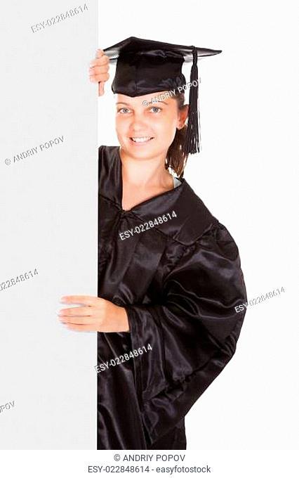 Graduate woman holding blank placard
