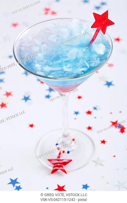 Blue-red-white drink in martini glass