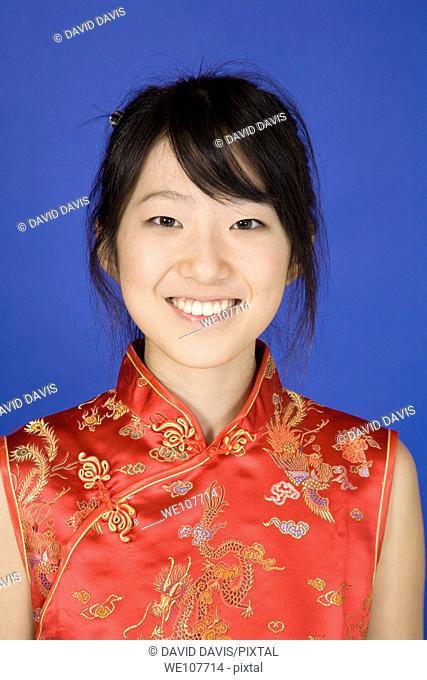 Beautiful young Asian girl posing for a portrait wearing a China Dress