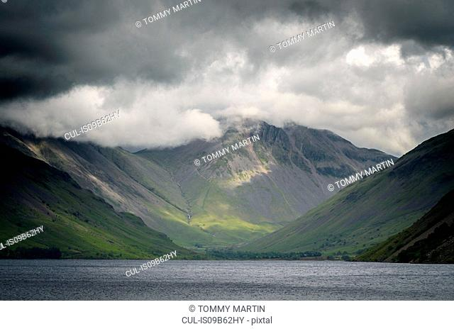 Storm clouds over Goat Crag across Buttermere lake, The Lake District , UK