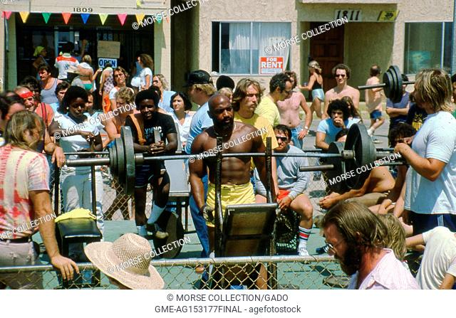 People exercising at the Muscle Beach Gym outdoor weight pen, located on Ocean Front Walk in Venice, California, June, 1978
