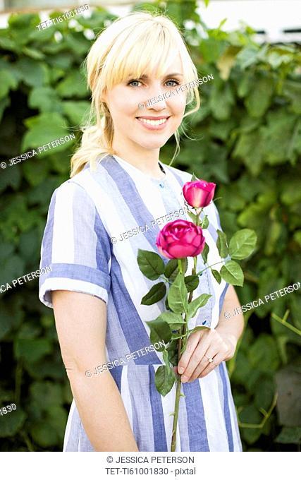 Woman holding purple rose