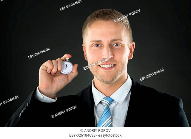 Portrait Of A Businessman Holding Stopwatch In His Hand