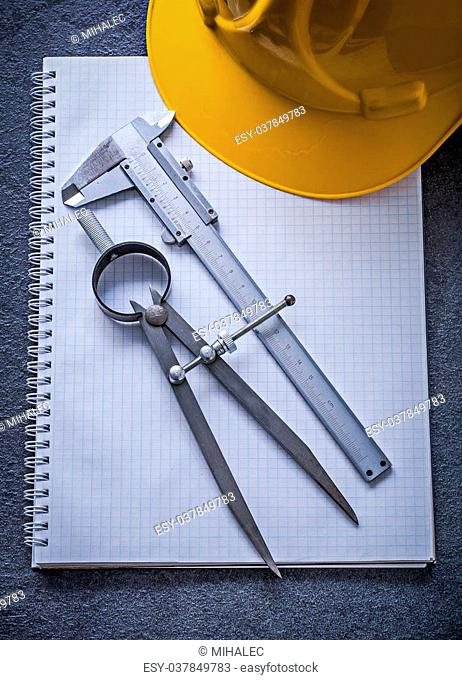 Notebook building helmet drawing compass vernier caliper construction concept